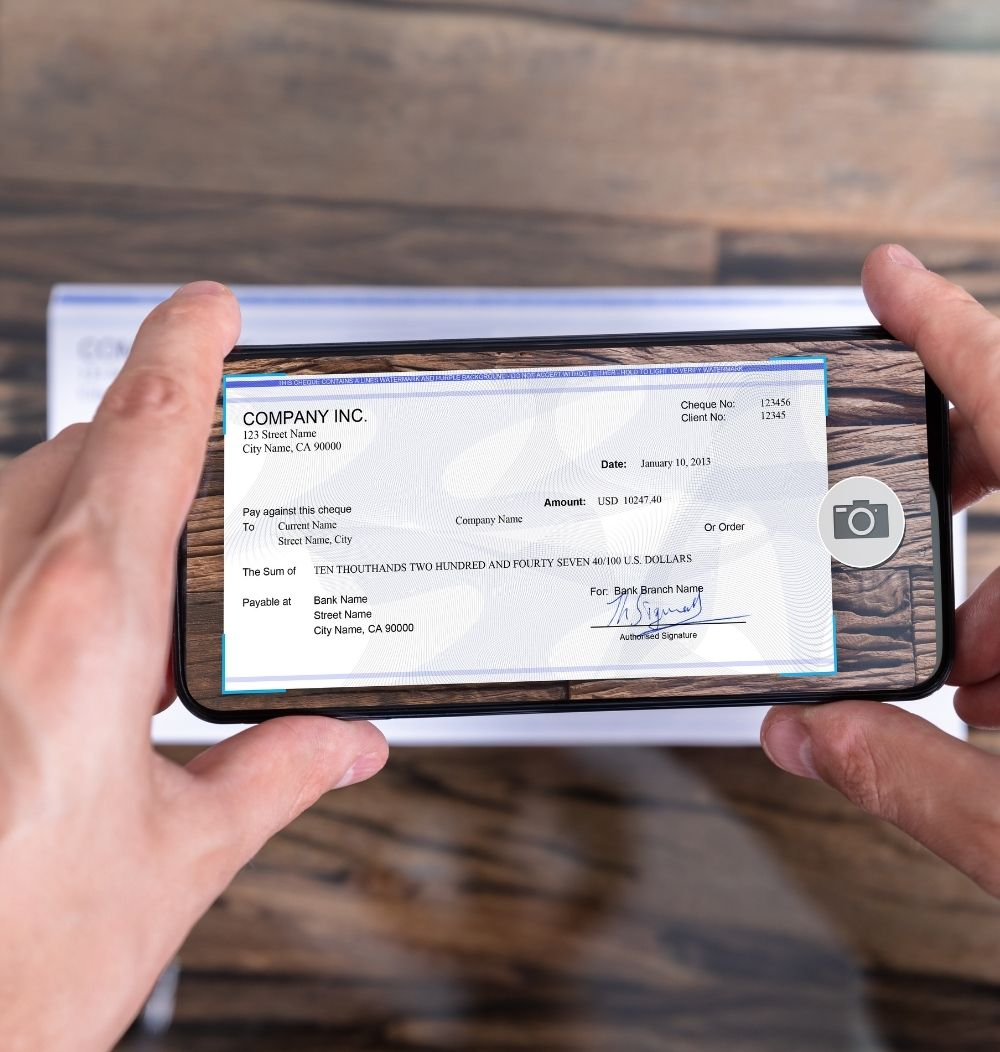 An image of a person using Mobile Deposit on their smartphone.